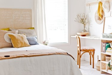 white bohemian bedroom with wooden details