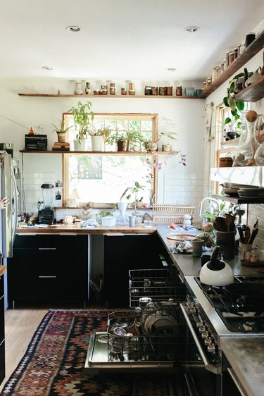 bohemian kitchen with open shelving and black cabinets
