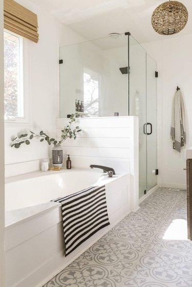 trending bathroom lighting with woven globe chandelier and patterned floor tile