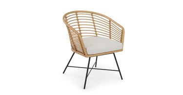 wicker lounge chair with white cushion