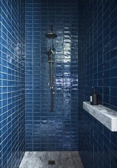 blue shower tile ideas with marble shower ledge