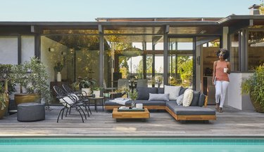 deck with outdoor furniture and pool nearby