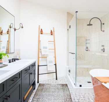 shower tile ideas in a standing shower with a black double vanity and patterened rug