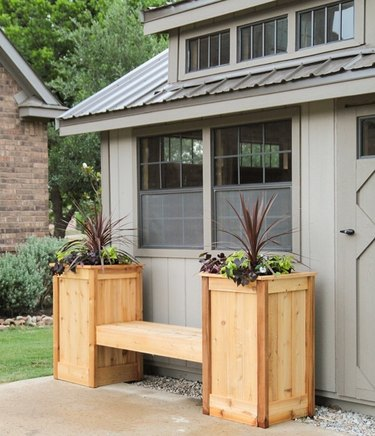 Modern shed in neutral colors with modern wood planters