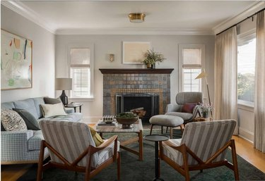 soft gray family room paint colors with white ceiling and patterned chairs