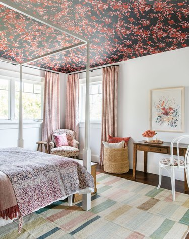 teen bedroom idea for girls with wallpapered ceiling and rosy drapery