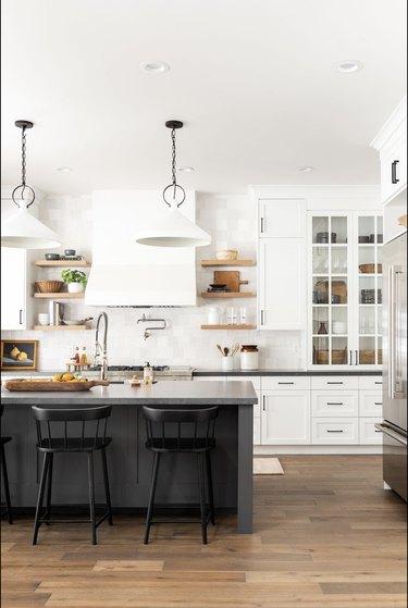 Black kitchen island table in white kitchen