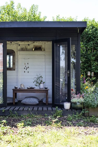 Modern shed with black exterior and French doors