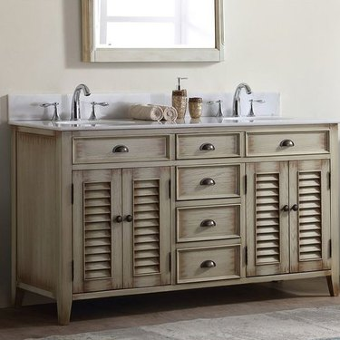 country bathroom vanity with double sink with doors and drawers for storage