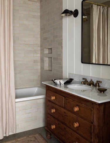 light gray shower tile ideas in bathroom woth vintage vanity and pink shower curtain