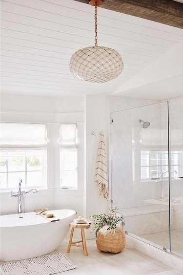 bathroom chandelier lighting idea with oval fixture over tub