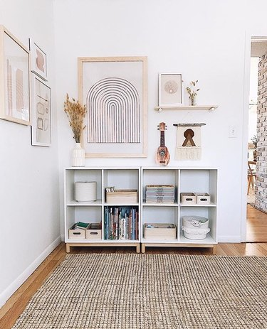 White corner featuring cubic storage and structural artwork