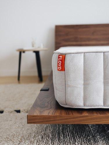 mattress on dark walnut platform bed
