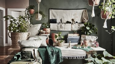 room with planters, hanging plants, and various textiles