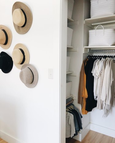 small bedroom organization ideas with hat display