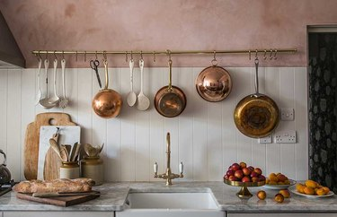 kitchen wall decor featuring hanging pots and pans