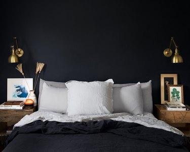dark guest bedroom idea with plush linens