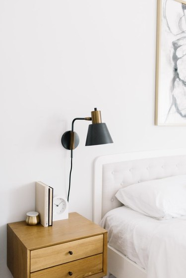 small bedroom organization ideas with nightstand topped with books