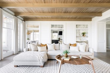 boho coastal living room with wood ceiling neutral furniture