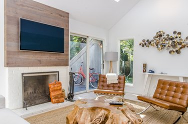 Family room with fireplace and TV layout paired with honey leather chairs.