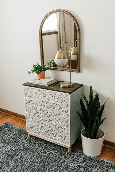 Set your finished makeover IKEA cabinet up in the entry for easy storage access.