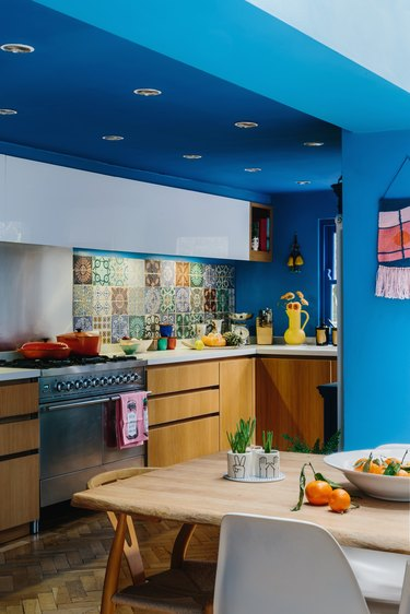 bright blue kitchen with wooden cabinetry