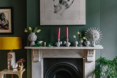 marble fireplace filled with Jonathan Adler interior accessories