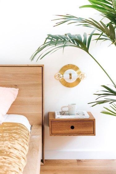 bedside plant in minimalist bedroom