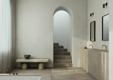 minimalist bathroom vanity made of concrete with two mirrors