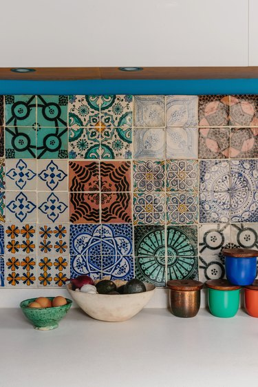 patterned kitchen tiles with colourful containers