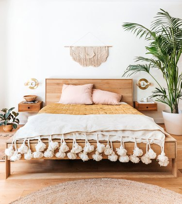 minimalist bedroom with pops of pink