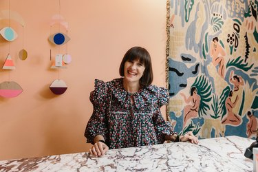 Zoe Anderson behind cash desk of Shoreditch-based homeware store