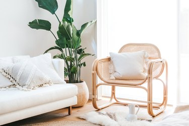 natural elements in living room - rattan lounge chair