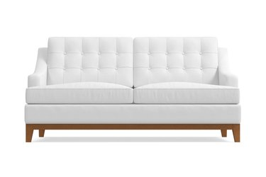 white tufted sleeper sofa