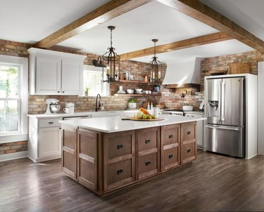 white rustic kitchen island with wooden beams and wooden island