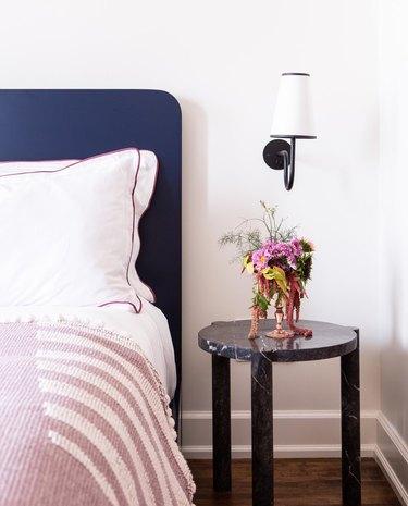 art deco inspired bedroom with black marble nightstand