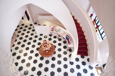 overhead view of black and white floor and large staircase
