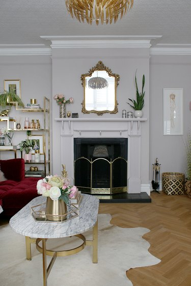 art deco living room with cowhide rug and gold accents