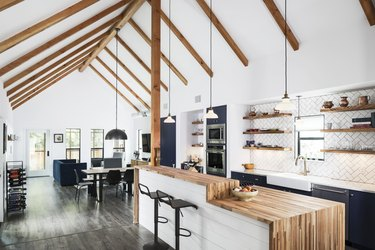 white kitchen with two tier rustic kitchen island