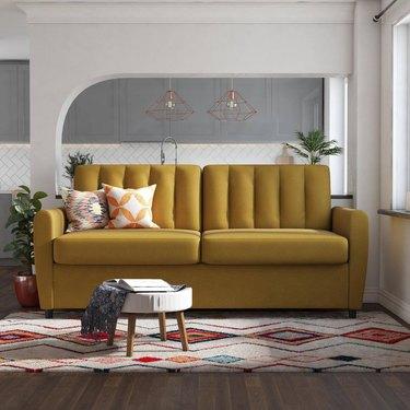 mustard sleeper sofa in living room