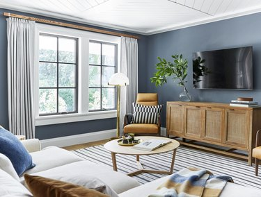 modern family room ideas with blue walls and velvet curtain