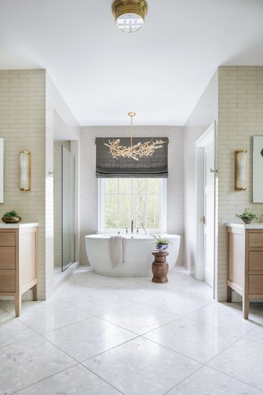 elegant bathroom lighting idea with gold branch-inspired chandelier