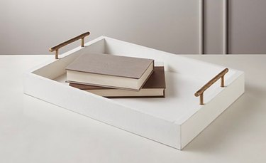white leather tray with two books