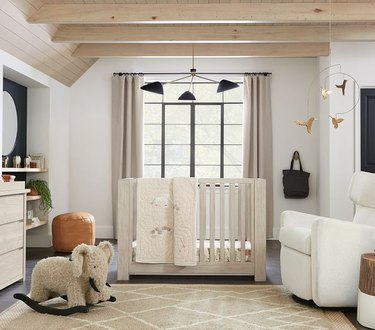 nursery room with large windows and beige carpet