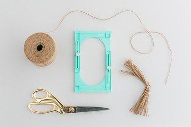 Use a tassel maker to fashion handmade tassels.