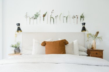 Plants above a headboard