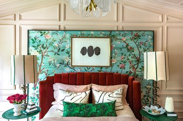art deco bedroom with layered patterns and floral wall mural