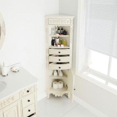 Single Door corner bathroom cabinet in Antique White in white bathroom
