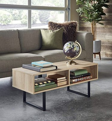 Wood coffee table with two open shelves and black metal legs