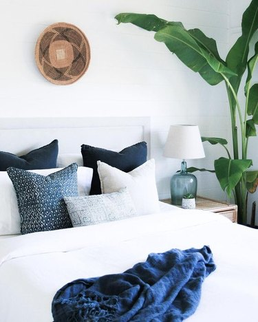 blue bohemian bedroom idea with pillows and blanket